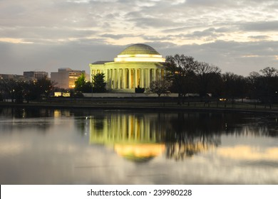 Washington DC - Thomas Jefferson Memorial with mirror reflections on water in a cloudy sunrise