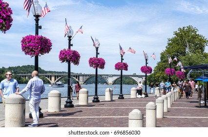 Washington DC, United States of America - August 6, 2017: Georgetown Waterfront Boardwalk on a Sunday Afternoon