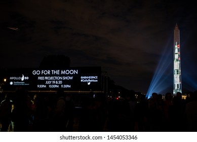 Washington, DC / United States - July 17, 2019: The Saturn V is projected onto the Washington Monument to celebrate the 50th Anniversary of the Moon Landing.