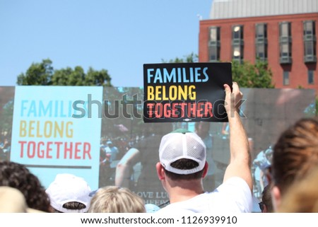 Washington, DC / United States - June 30, 2018: Thousands take to the streets of DC to protest the separation of families at the border. Families Belong Together
