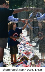 WASHINGTON, D.C. / United States - MAY 26, 2014: Visitors at the Vietnam Veterans Memorial on May 26, 2014, in Washington, D.C.