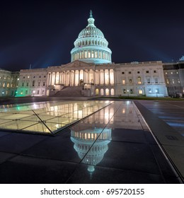 Washington DC, US Capitol Building at night with mirror reflection.