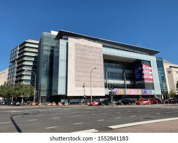 Washington, DC / US - November 06, 2019: Angled broad street view of The Newseum's ground level facade, museum desiccated to free speech and journalism that closes for good at the end of 2019