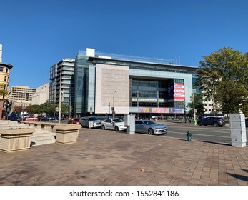 Washington, DC / US - November 06, 2019: Very wide angle shot of the Newseum as seen from across the street at an angle with the entire intersection at street level round view.