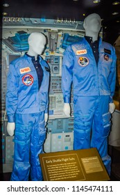 Washington DC, USA; 05 24 2014: The blue men women space suits NASA astronauts wore when flying on the space shuttle during ascent and reentry exhibited at the Smithsonian Air and Space Museum.