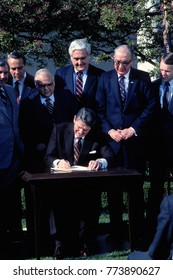 Washington, DC. USA, 10th April,  1984 President Ronald Reagan signing the Agricultural Programs Adjustent Act (Farm Bill) of 1984 in the Rose Garden of the White House.