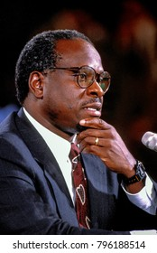 Washington DC., USA, 10th September,1991  Clarence Thomas nominee for Associate Justice of the United States Supreme Court ponders questions from the Senate Judiciary Committee during his confirmation