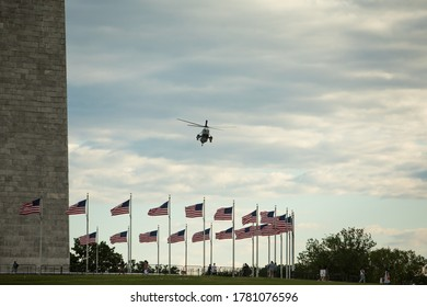 Washington, DC, USA - 11 Juli 2020: Marine One Helicopter in Flight at the Washington Monument with US President onboard, Copy Space