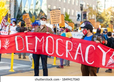 Washington DC, USA 11/06/2020: A group of democratic socialists wearing rose handshake face masks are marching near White House to celebrate the defeat of Donald Trump in US elections.