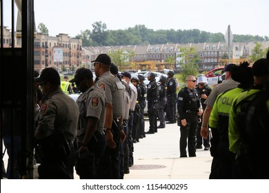 Washington, D.C., USA. 12 Aug 2018. Police line up in front of the Vienna metro station ahead of white nationalist protestors arriving to take the train into to the Unite the Right protest in D.C.