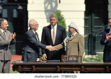 Washington, DC. USA, 13th September, 1993.  Prime Minister Yitzhak Rabin of Israel and Palestine Liberation Organization chairman, Yasser Arafat, shake hands  after signing the Peace Accords