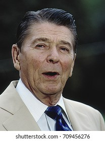 Washington DC. USA, 13th September,1984 President Ronald Reagan has an informal exchange with reporters on foreign and domestic issues on the Lawn of the White House prior to departing on Marine One