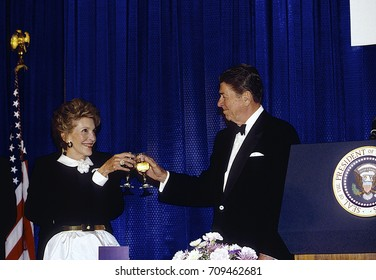 Washington, DC. USA 15th May,1986 President Ronald Reagan and First Lady Nancy Reagan propose a toast at the annual White House News Photographers Black Tie Awards Dinner.