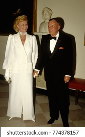 Washington DC. USA, 18th June, 1984Frank and Barbara Sinatra pose as they arrive for the State dinner at the White House. Frank was the entertainment that evening.