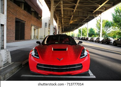 Washington D.C., USA - 19.08.17: Chevrolet Corvette Convertible sports car parked in Georgetown area. Red supercar is one of the most common options for performance-seeking USA consumers.