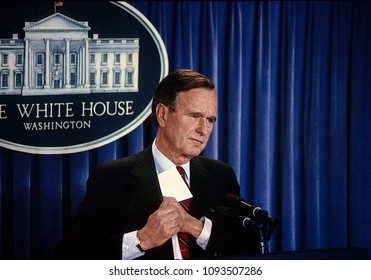 Washington, DC., USA,  1988President George H.W. Bush talks with and answers reporters questions during a press briefing in the White House Press briefing room.