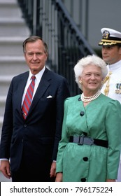 Washington DC., USA, 1989 President George H.W. Bush and First Lady Barbara Bush stand at the South Portico of the White House awaiting the arrival of Diplomatic guest.