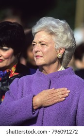 Washington DC., USA, 1990  First Lady Barbara Bush holds her hand over her heart as the American Athem is played at the White House during official State visit ceremony on the South Lawn.