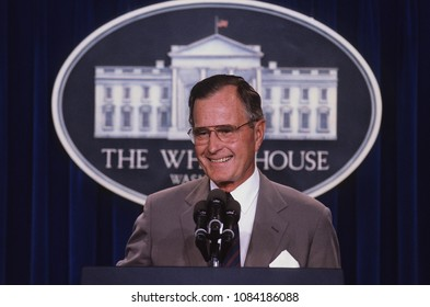 Washington, DC., USA,  1990 President George H. W. Bush stands at the podium as he responds to reporters questions during a news conference in the press briefing room at the White House.