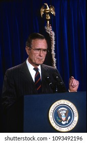 Washington, DC., USA,  1991President George H.W. Bush talks with and answers reporters questions during a press briefing in the White House Press briefing room.