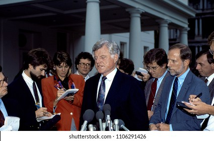Washington, DC., USA, 1992 Senator Edward (Ted) Kennedy talks with reporters outside the White House west wing driveway.