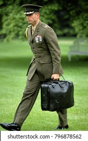 """Washington DC. USA,  1992 US Marine Corps Major serving as a Military Aid at the White House carries the """"Nuclear Football"""". It functions as the mobile hub in the strategic defense system of the US"""