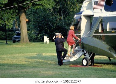 """Washington DC. USA,  1994 President William Jefferson Clinton along with First Lady Hillary Rodham Clinton and their daughter Chelsea walk across the South Lawn towards """"Marine One"""""""