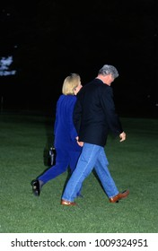 """Washington DC. USA, 1994 Presient William Clinton and First Lady Hillary Rodham Clinton walk hand in hand towards """"Marine One"""" for flight to Camp David."""