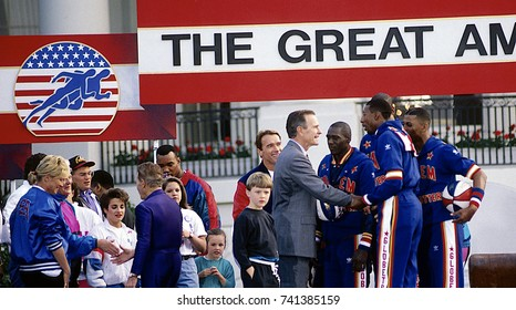Washington DC. USA, 1st May, 1992 President George H.W. Bush is joined on stage at the Great American Workout  by Arnold Schwarzenegger. Also are members of the Harlem Globetrotters basketball team.
