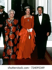 Washington DC. USA 20 February, 1991 President George H.W. Bush with his wife Barbara pose at the entrance to the North Portico of the White House with Queen Margrethe II of Denmark for state visit