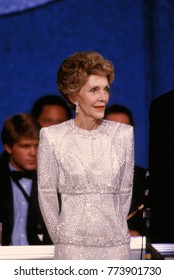 Washington, DC. USA, 20th January, 1985 First Lady Nancy Reagan listens to her husband President Ronald Reagan as he addressses the crowd at one of their Inaugural balls after he was sworn in today