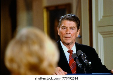 Washington, DC. USA 22nd May, 1984 President Ronald Reagan answers reporter's question during news conference in the East Room of the White House.
