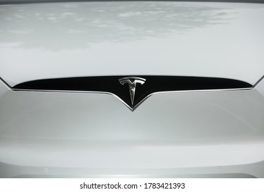 Washington, DC, USA - 24 July 2020: Close-up of the Tesla Logo at tthe Front Grille of a white Car