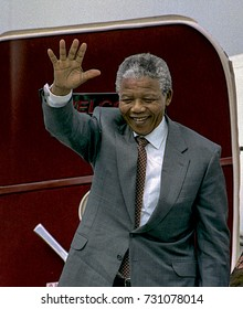 Washington, DC. USA, 24th June, 1990 Nelson Mandela along with his wife Winnie arrive at National Airport. He is greeted by Randall Robinson, Effie Barry, and Congressman Walter Fountry