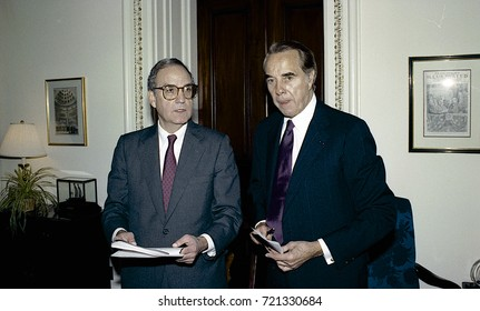 Washington DC. USA, 27th October, 1990Senators George Mitchell and Robert Dole look over the budget bill before sending to the full senate for approval.