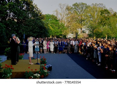 Washington DC. USA, 29th April, 1993 President William Clinton standing behind his wife Hillary Rodham Clinton and Tipper Gore as they deliver remarks at the reception for the Health Care Task Force