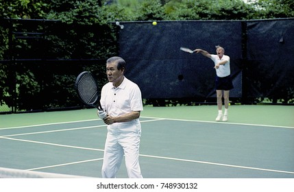 Washington DC. USA, 2nd July, 1991 President George H.W. Bush plays doubles tennis with South Korean President Roh Tae Woo, during President Woo's state visit to the White House.