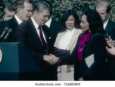 Washington DC. USA, 2nd November, 1983 President Ronald Reagan after signing a bill creating a federal holiday to honor  Martin Luther King. Reagan shakes hands with Coretta Scott King