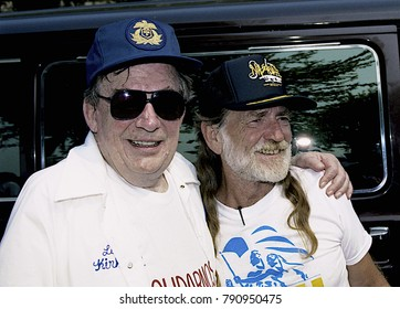 Washington, DC. USA, 31st August, 1991 AFL-CIO President Lane Kirkland gets together with Country Music artist WIllie Nelson during the AFL-CIO Rally and concert in downtown DC.