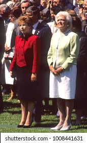 Washington, DC. USA, 31st May, 1990 First Lady Barbara Bush stands with Russian First Lady Raisa Gorbachev on the South lawn of the White House during Official State arrival ceremony.