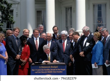 Washington DC., USA, 5th August,1997 President William Clinton signs the Balanced Budget Act Bill of 1997 surrounded by members of the House and Senate at a South Lawn ceremony of the White House