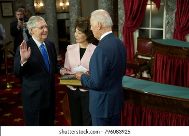 Washington DC., USA 6th January, 2015 Opening day of the 114th congress. Senator Mitch McConnell with his wife Elaine Chao holding the bible is sworn in by  Vice-President Joseph Biden