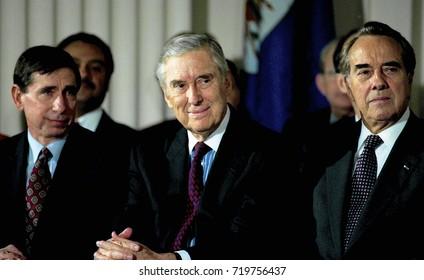 Washington DC. USA, 8th December, 1993 President William Jefferson Clinton signs the North American Free Trade Agreement.  L-R Mickey Kantor Lloyd Bentsen, Bob Dole.
