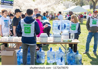 Washington DC, USA - Apr.12,2015 : Volunteer giving out water after the marathon in the event of Credit Union Cherry Blossom 5K run-walk