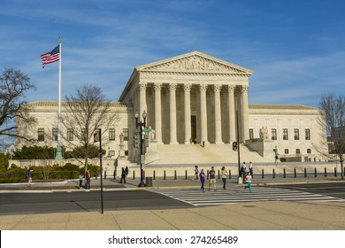 WASHINGTON, DC, USA - APRIL 06, 2015: United States Supreme Court building exterior. People crossing street.