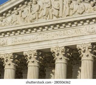WASHINGTON, DC, USA - APRIL 06, 2015: United States Supreme Court building exterior. Equal Justice Under Law phrase engraved on facade.