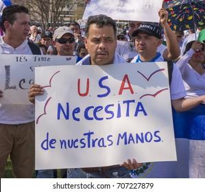 WASHINGTON, DC, USA - APRIL 10, 2013: Immigration reform rally at U.S. Capitol. Sign translation: USA needs our hands.