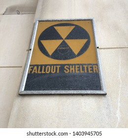 Washington DC, USA April 2, 2018 A fallout shelter sign, a relic from the Cold War days, still hangs on a government wall in Washington, DC