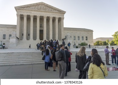 Washington, DC / USA - April 23, 2019: people stand in line in an attempt to get into the Supreme Court to watch the arguments in the Census case, which is being argued today.
