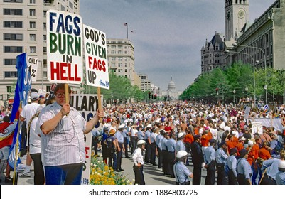 Washington DC, USA, April 25, 1993 Members of the Westboro Baptist Church from Topeka Kansas holding racist, hate, homophobic, signs protesting at the Lesbian and Gay March on Washington